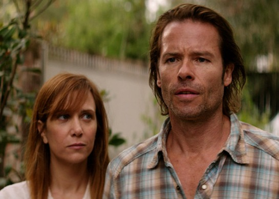 Guy Pearce and Kristen Wiig in Hateship Loveship (2013).